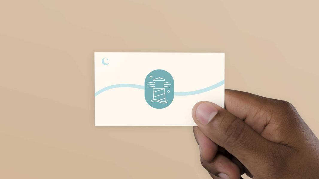 Onama-Hand_holding_business_card.jpg