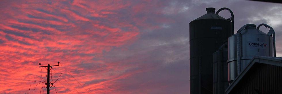 sunset behind silos