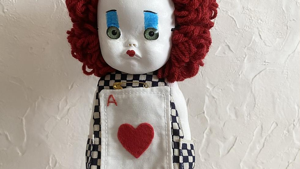 Handmade doll wearing face mask