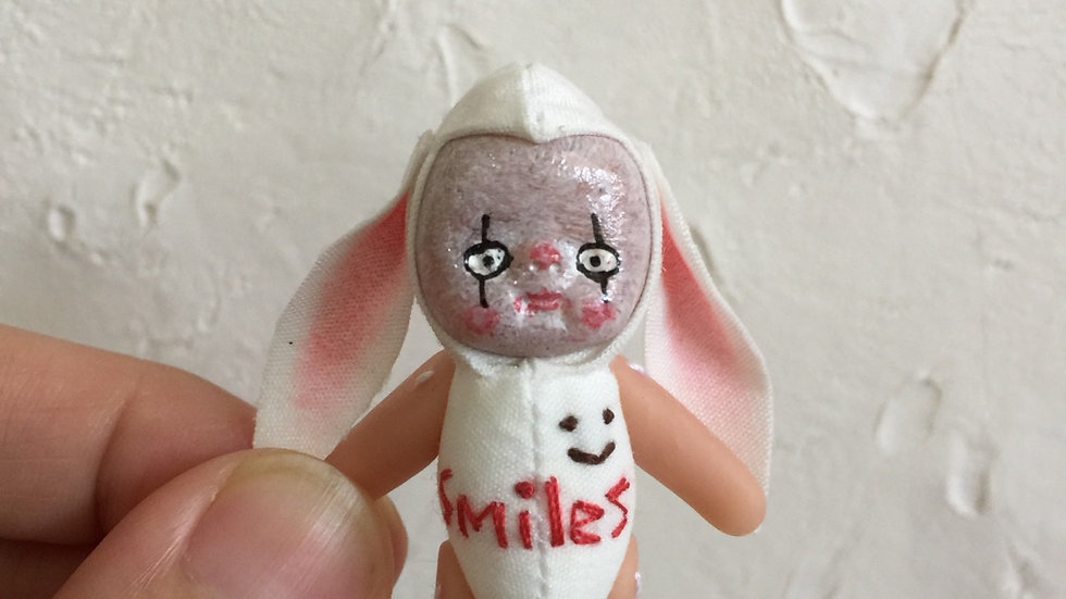 Tiny clown doll