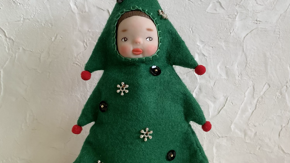 Handmade doll wearing Christmas tree costume
