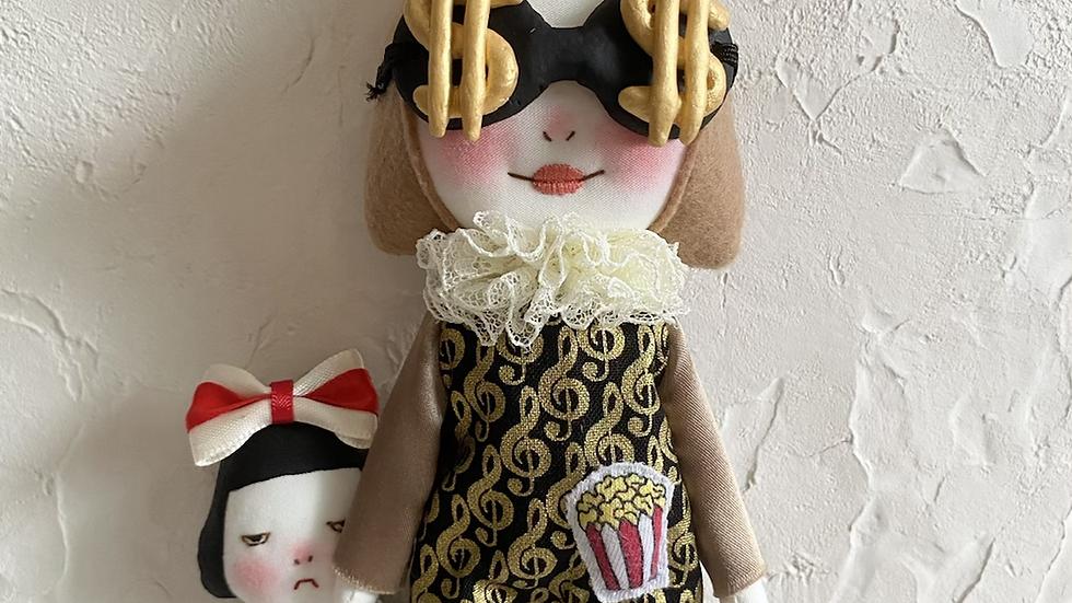Handmade doll wearing money glasses