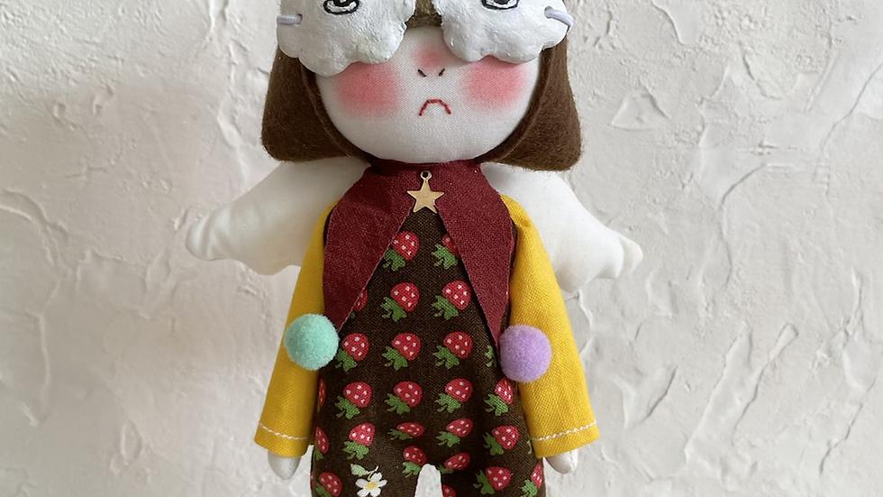 Handmade Doll wearing rainbow glasses