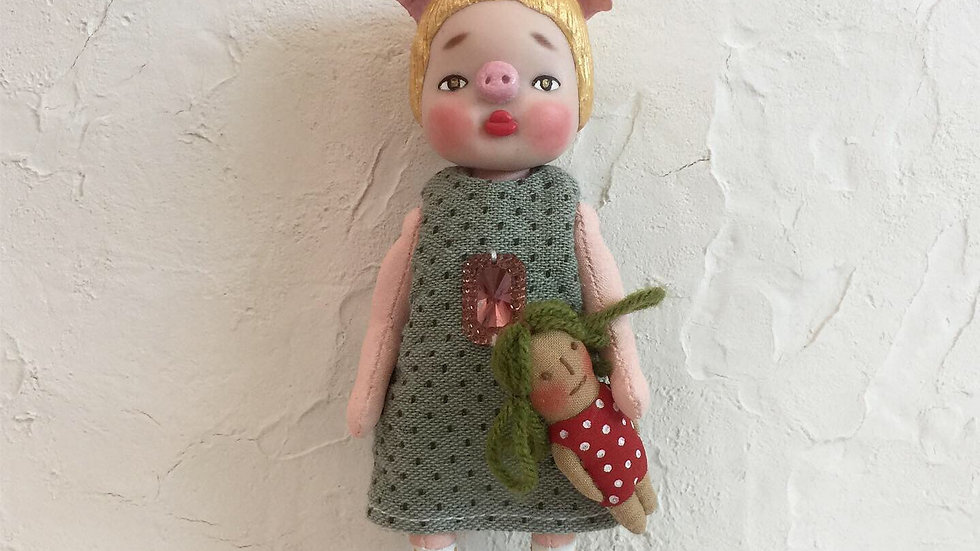 Pig girl with her doll