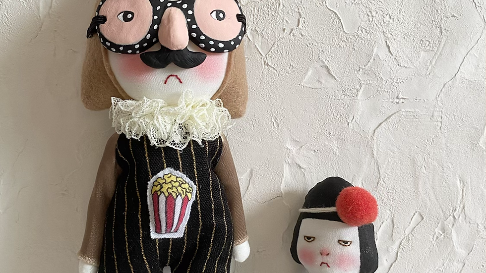Handmade doll wearing funny glasses