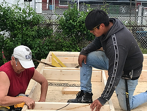 Sheri and Edgar work on a framing sectio