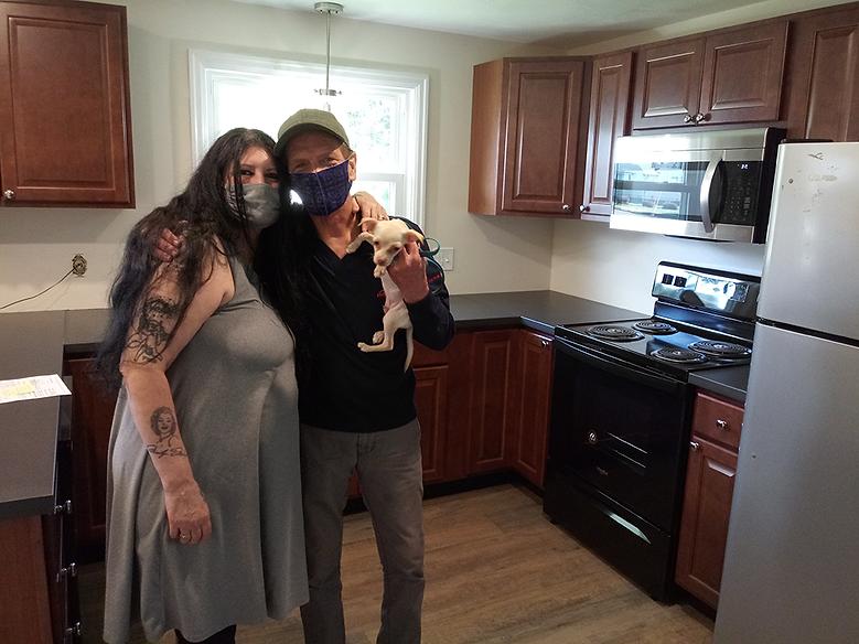 2020.10.01 John, Karen, dog kitchen.png