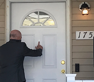 175 reverend blesses house.png