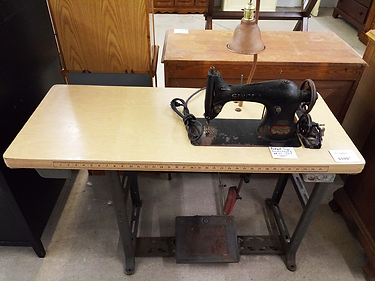 antique sewing machine with table.png