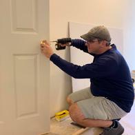 Volunteer with door hinge September 2019