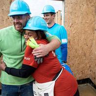 Volunteers hugging January 2020.png