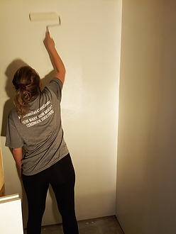 woman painting downstairs closet 2020.10