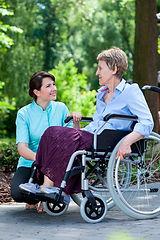 Caregiver providing mobility assistance
