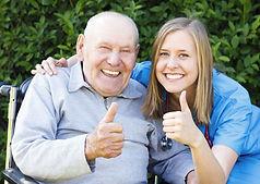 Dad gives thumbs up with caregiver
