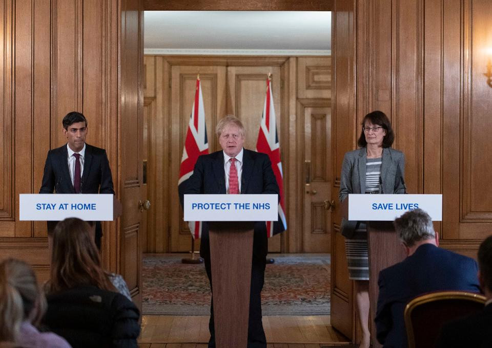 Chancellor of the Exchequer Rishi Sunak (L) and Deputy Chief Medical Officer Dr Jenny Harries (R) look on as British Prime Minister Boris Johnson (C) speaks during a daily press conference at 10 Downing Street on March 20, 2020 in London, England. (Photo by Julian Simmonds - WPA Pool/Getty Images)