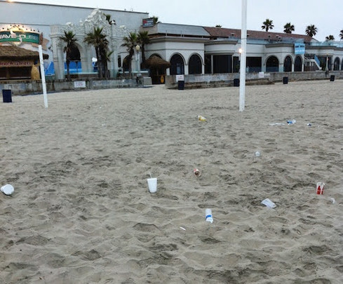 PLASTIC BOTTLES IN THE SAND