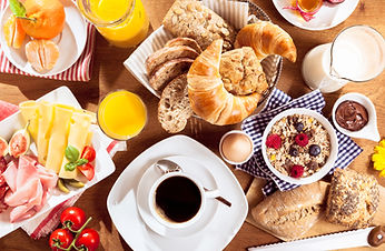Top view of coffee, juice, fruit, bread