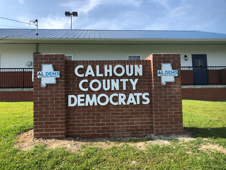The 'finishing touch' on the Calhoun County Democrat HQ sign.  Join Us.