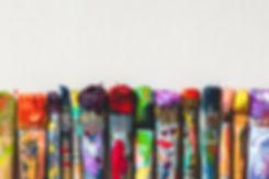 Row of artist paintbrushes closeup on ar