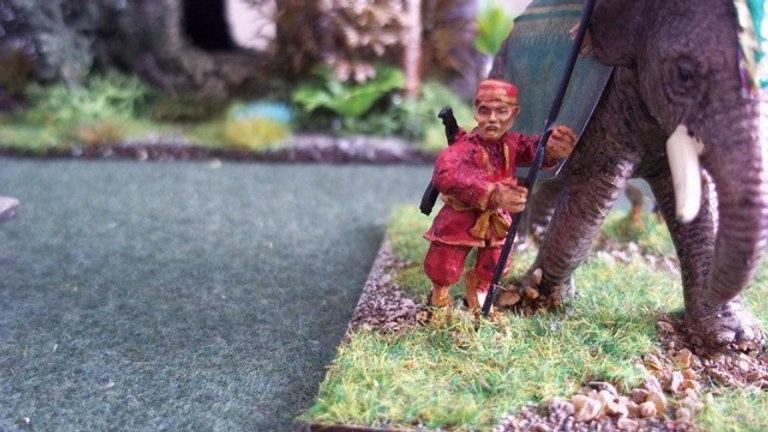 SE12 Spearman / foot in pillbox cap advancing at high port, no shield.
