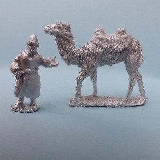 CA22 Camel and handler in Kalpak hat.