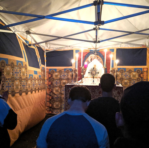 An adoration tent is set up for pilgrims to visit. It was full all evening.