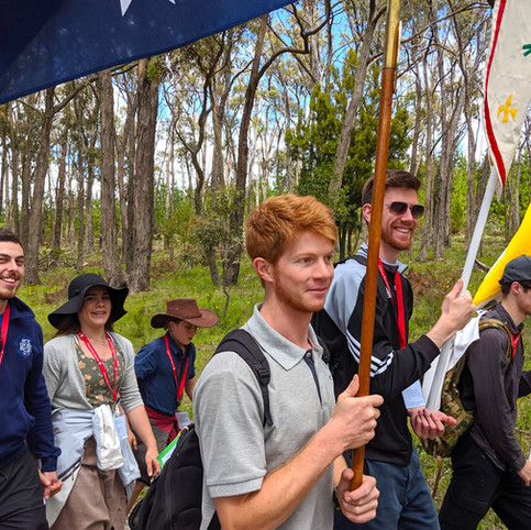 There's alwyas a smile to be found...even when carrying heavy flags.