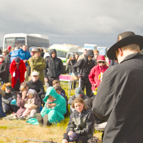 With grey clouds looming, the pilgrims still managed to concentrate on Father's words of wisdom.