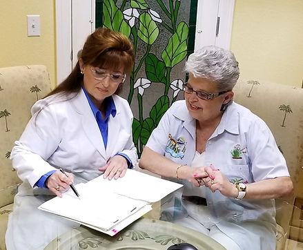 Donna and patient in consult room.jpg