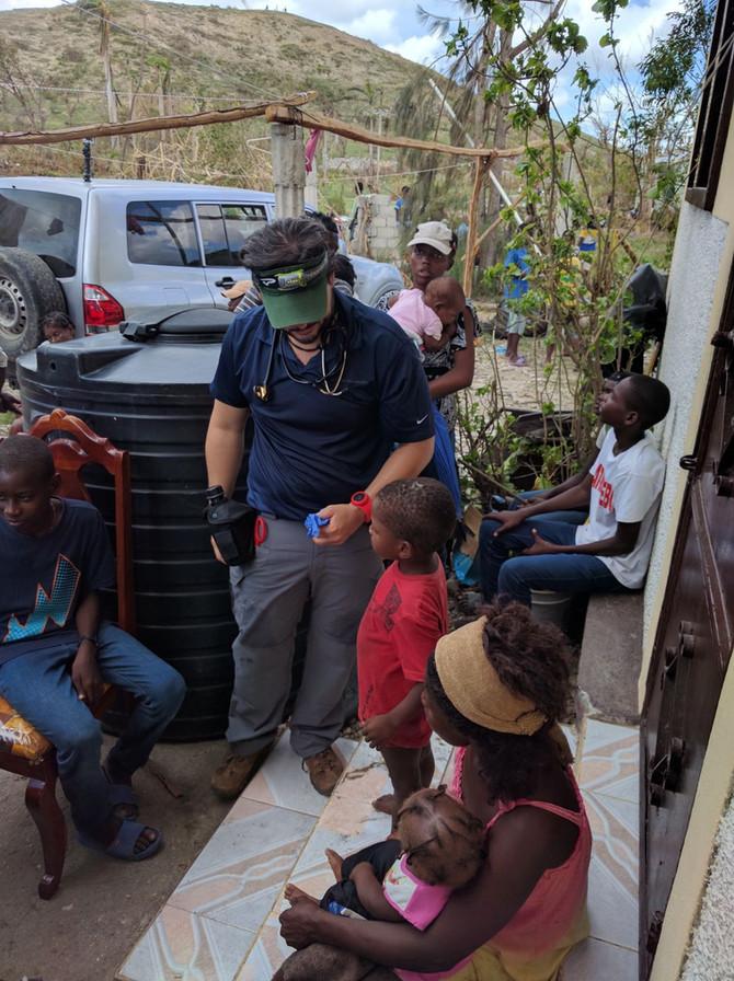 IHI and partners provide medical care outside Chantal, Haiti.