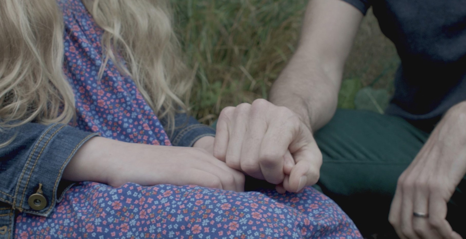 Growing Charlotte film Michael and Charlotte hold hands