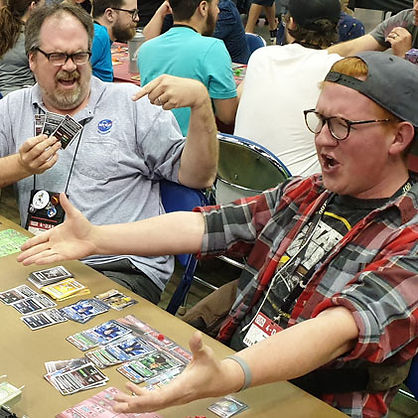 Board game players reacting to their game of Lander