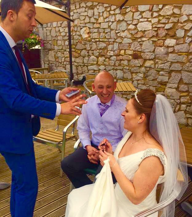 Bridgend magician performs at a wedding in St Mary's Golf Club, Pencoed