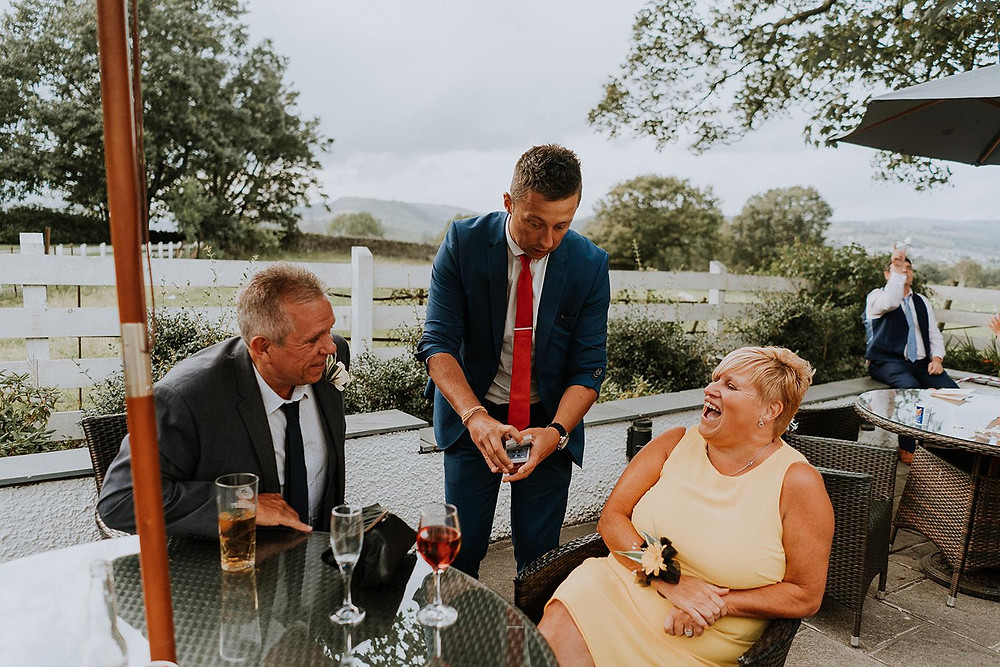 Cardiff magician James Hawker performs at a wedding in Llechwen Hall