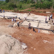 Flyover of school buildings and boys dorm construction
