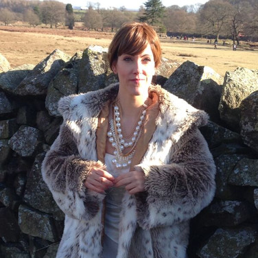 white wedding dress, fur coat and pearls