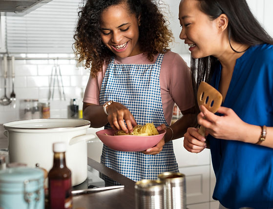 Diverse women cooking in the kitchen tog