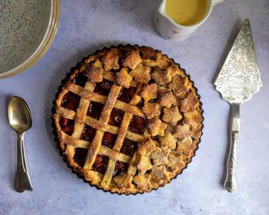 Plum, almond and cardamom tart