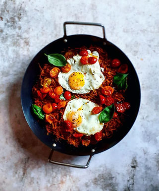Oven rösti with fried eggs and roast tomatoes.