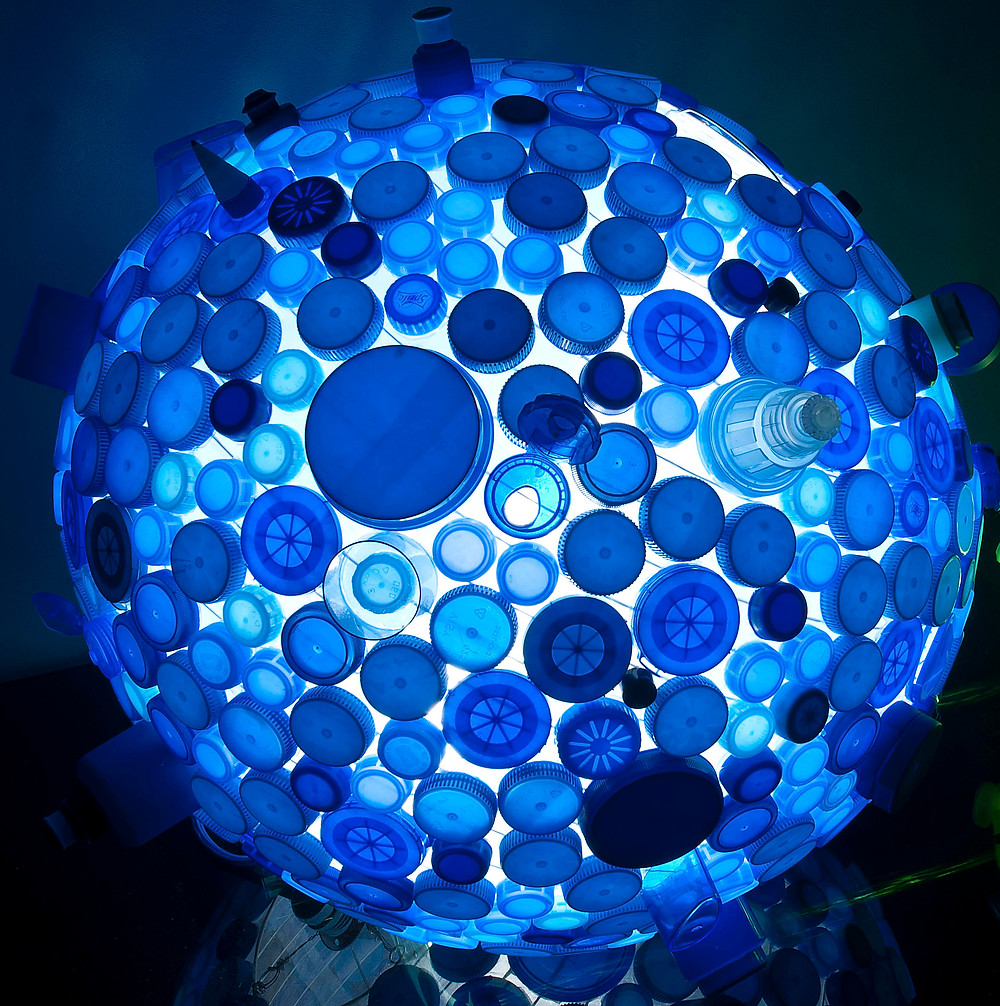 Light made of recycled plastic lids