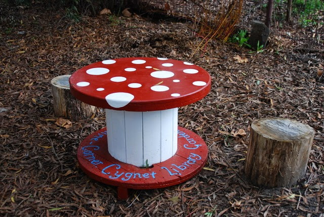 This recycled mushroom table is enjoyed by children visiting the library