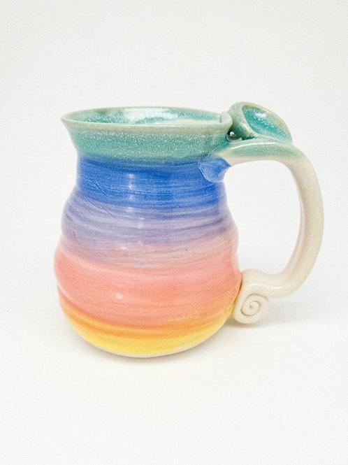 Swirling rainbow mug, right hand