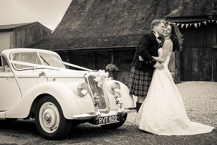 Real Bride in a Sarah Treble Wedding Dress by old car