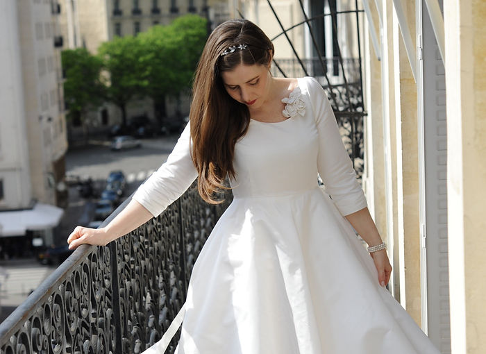 Real bride in a Sarah Treble Wedding dress on a balcony in Paris