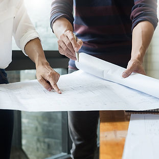 project-manager-holding-plans-2.jpg