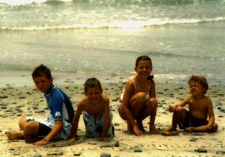 Zach, Michaela, Javan Spoolstra on th beach