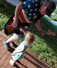 Taylor Playing Bass Crop.jpg