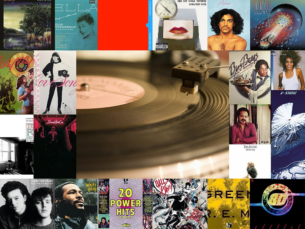A collage of various vinyl albums, such as Red Hot Chili Pepper's Greatest Hits, Marvin Gaye's What's Going On, Foster the People's Sacred Hearts Club, etc.