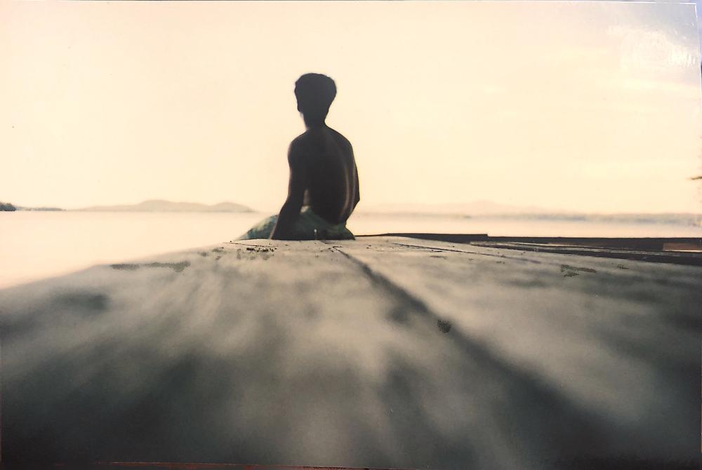 A man in swimming trunks on the shore of Lake Winnipesaukee at Kabeyun, New England