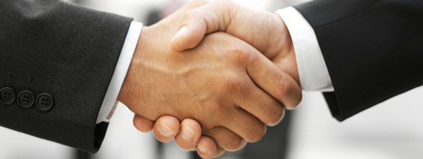 Handshake at the end of a business mediation session.